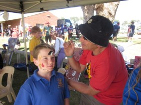 Kevin Burgemeestre facepaints for NAIDOC festival